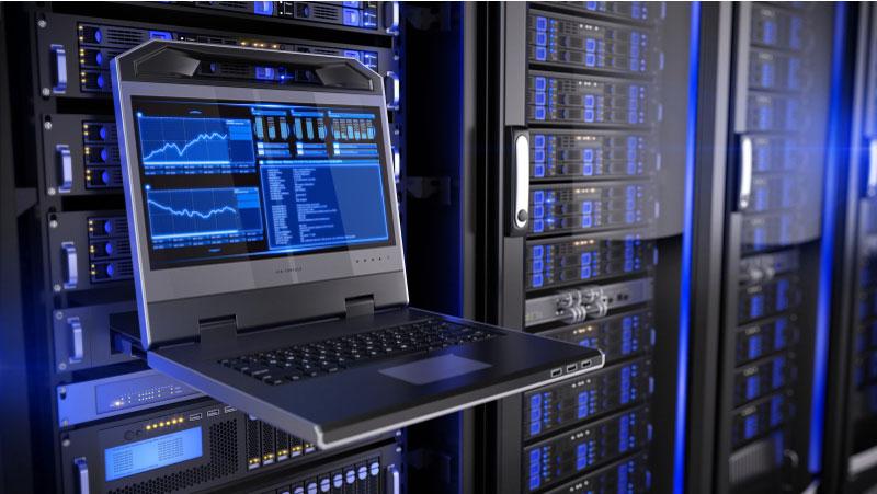 Rack-mount LED console in server room data center. Information technology.
